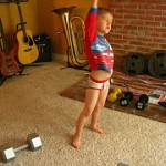 boy lifting weights in undies