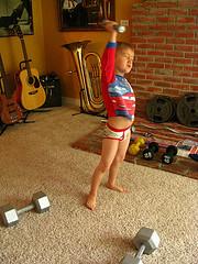 boy lifting weights in undies
