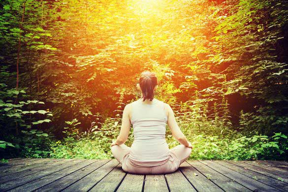 bigstock-Young-woman-meditating-in-a-fo-150115jw