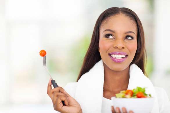 Bigstock Cute Black Woman Eating Vegeta 50974277