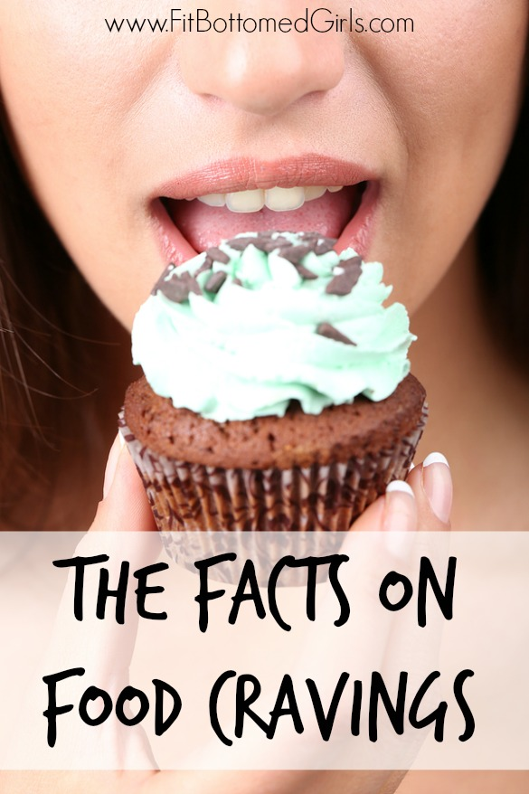 Closeup of woman eating chocolate cupcake