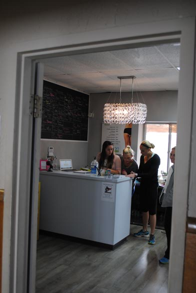 The front desk. I'd love to steal that chandelier for my office.