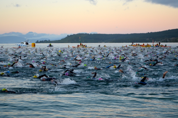 The swim start at Ironman New Zealand, which takes place in Lake Taupo