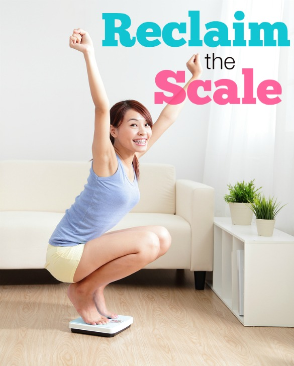 Happy Woman smiling on weighing scales at home asian