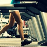 woman running on a treadmill in a fitness club, sport in the fitness club