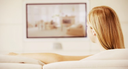 Teen relaxing at home watching tv