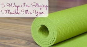 A yoga mat is set on the floor