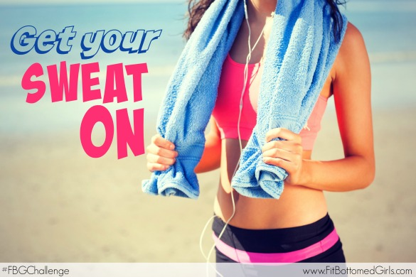 Close up mid section of a beautiful healthy woman with towel around neck standing on beach