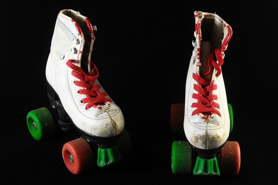 Used Vintage Consumed Roller Skate on a Black Background