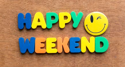 happy weekend colorful word on the wooden background