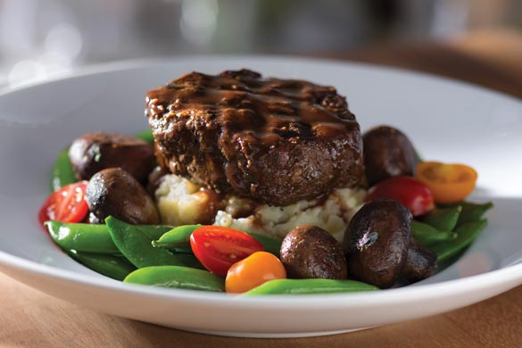 Seasons 52 Oak Grilled Filet Mignon with seasonal vegetables has only 470 calories, while another popular chain's Cowboy Ribeye (with no side) has a whopping 1690! You decide. Credit: Seasons 52