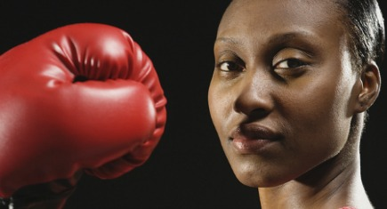 African American woman wearing boxing glove
