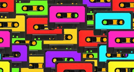 Colorful 80s analoge audio tape background repeatable pattern
