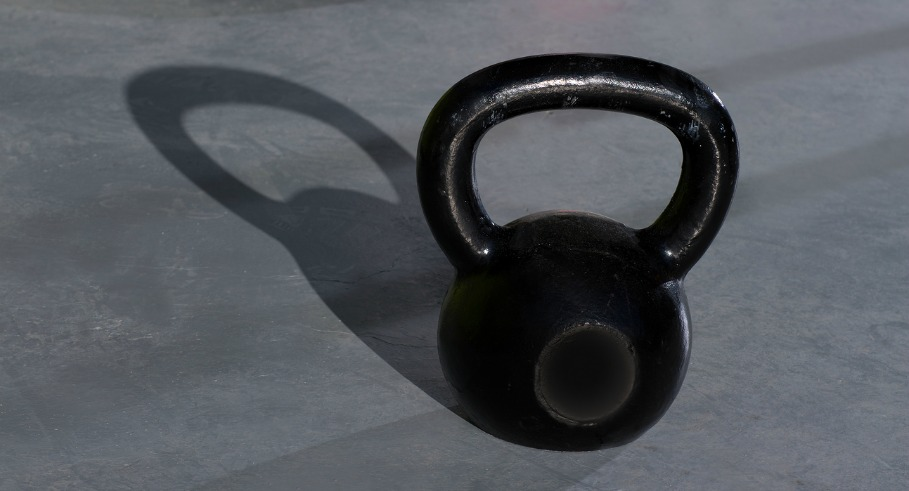 Crossfit Kettlebells ropes  in fitness gym floor