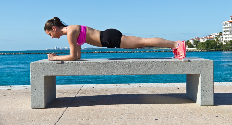 Hispanic woman doing a pilates plank for fitness