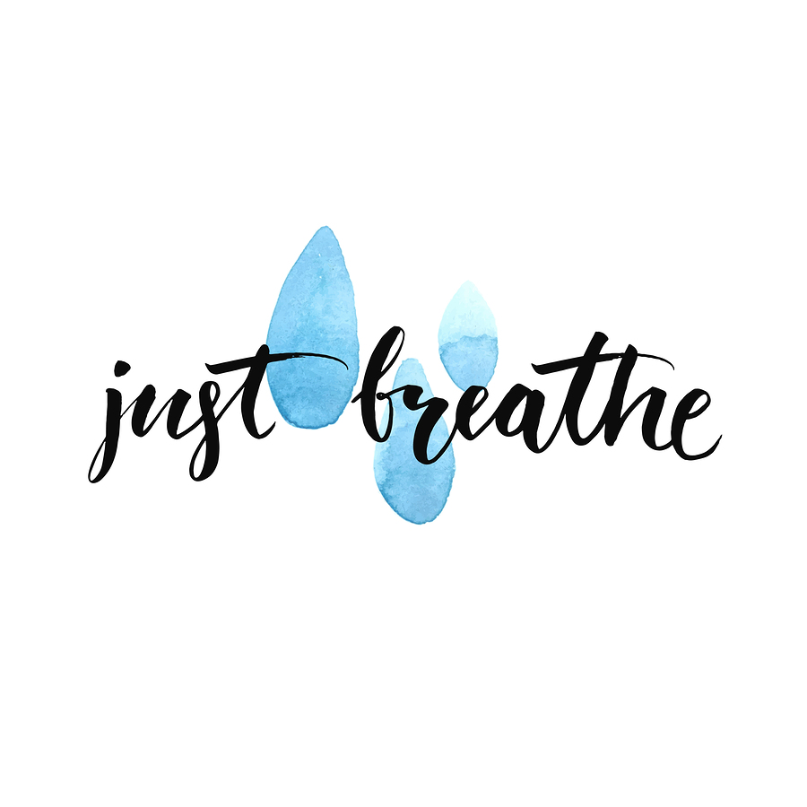 Just breathe. Inspirational quote calligraphy at blue watercolor