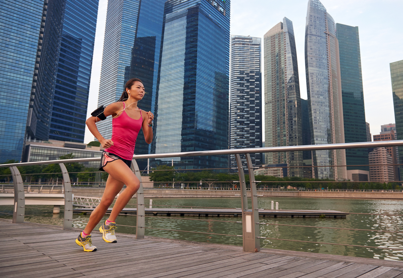 asian chinese sporty running woman working out running outdoors