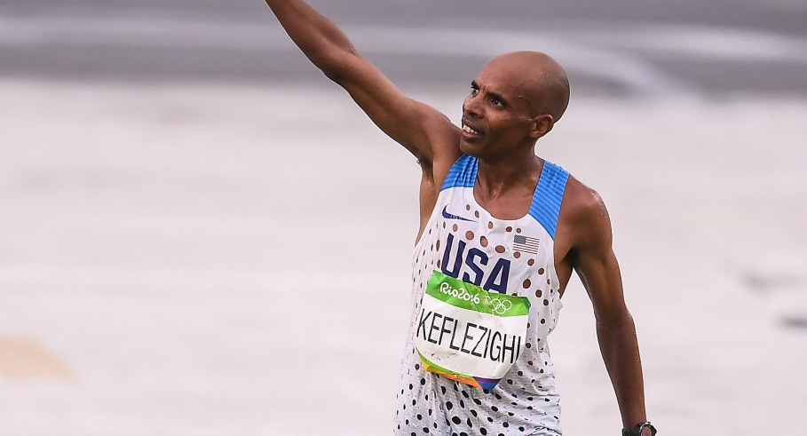 Rio , Brazil - 21 August 2016; Mebrahtom Keflezighi of USA crosses the finish line in the Men's Marathon at Sambódromo, Maracanã, during the 2016 Rio Summer Olympic Games in Rio de Janeiro, Brazil. (Photo By Brendan Moran/Sportsfile via Getty Images)