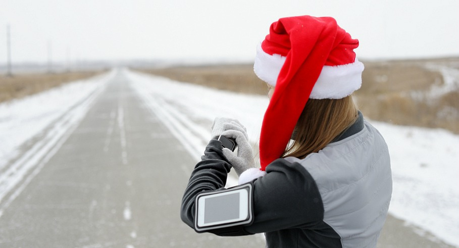 Smart Watch for sports. Jogging training for marathon. Santa hat. Happy New Year!
