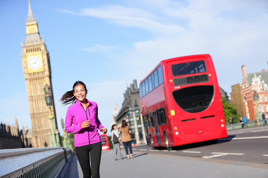 London lifestyle woman running near Big Ben. Female runner joggi